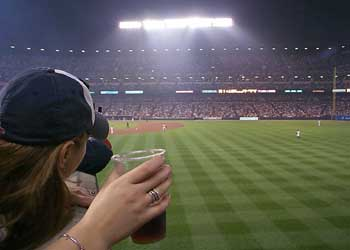 Our View of the outfield, Colleen and her beer